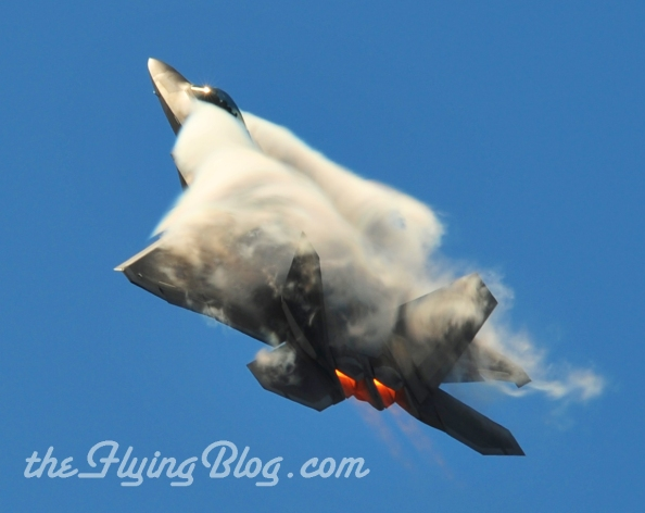 F-22 Raptor performing a high G-Force maneuver. Check out www.bullercreations.com for more aviation photos.